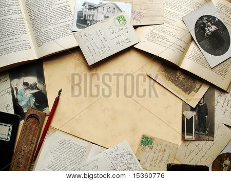 Vintage background with old books, postcards and photographs