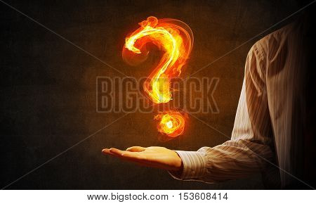 Close of businessman hand showing burning fire sign