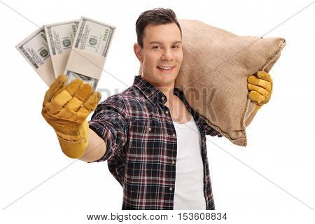 Male farmer posing with a burlap sack and money bundles isolated on white background