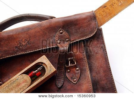 Vintage schoolbag with ruler and pen-case, detail, isolated