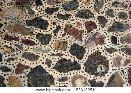 Stones at the wall of the pyramid of the moon in Teotihuacan, Mexico