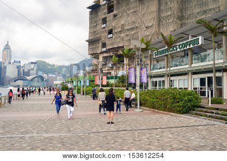 HONG KONG - 06 MAY, 2015: Starbucks coffee shop on Avenue of Stars. The Avenue of Stars, modelled on the Hollywood Walk of Fame, is located along the Victoria Harbour waterfront in Tsim Sha Tsui, HK.
