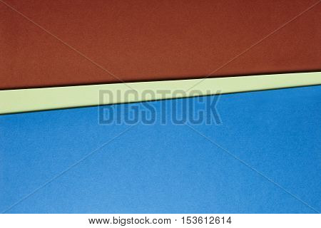Colored cardboards background in brown green blue tone. Copy space. Horizontal