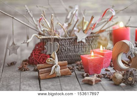 Composition of candles and natural decor on wooden background, close up view