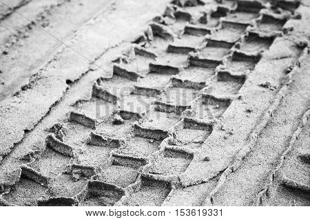 Tire Track On Gray Sandy Ground