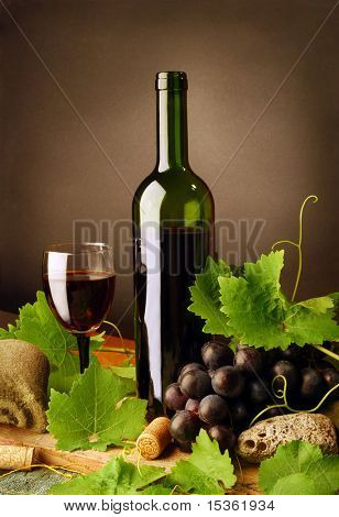 Red wine composition on dark background