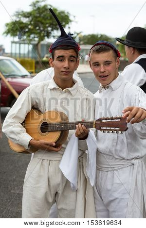FUNCHAL, MADEIRA, PORTUGAL - SEPTEMBER 4, 2016: Two boys  in traditional costume. Madeira Wine Festival - Historical and Ethnographic parade in Funchal on Madeira. Portugal