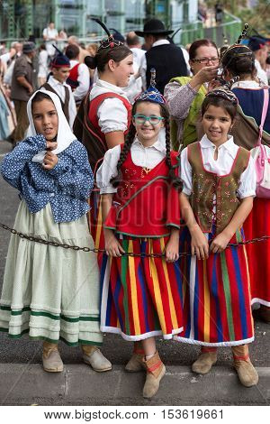 FUNCHAL MADEIRA PORTUGAL - SEPTEMBER 4 2016:Three girl in traditional costume. Madeira Wine Festival - Historical and Ethnographic parade in Funchal on Madeira. Portugal