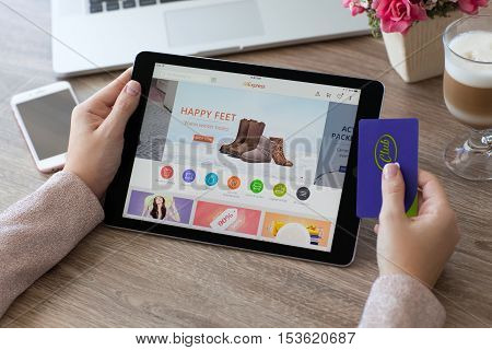 Alushta Russia - October 9 2016: Woman holding a iPad Pro with Internet shopping service Aliexpress on the screen. iPad Pro was created and developed by the Apple inc.