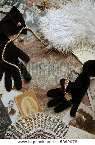 Vintage memories with old photos, gloves, fan and jewelry