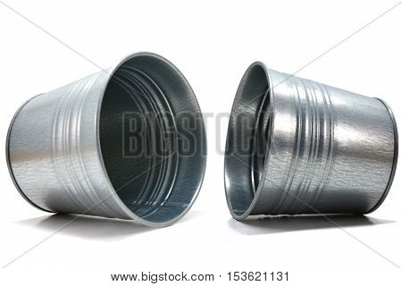 Steel cans falling with white background, stationary