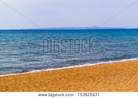natural landscape the sandy sea coast and the clear sky with the horizon