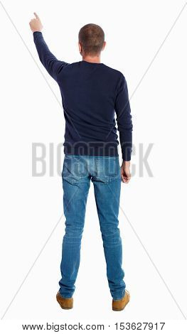 Back view of  pointing young men in shirt and jeans. Young guy gesture. Rear view people collection. backside view of person.  Isolated over white background. guy in black sweater is pointing upwards