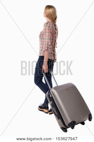back view of walking  woman  with suitcase. beautiful girl in motion.  backside view of person.  Rear view people collection. Isolated over white. Girl with very long hair is on the side with suitcase