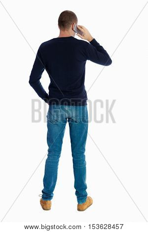 Back view of  pointing young men talking on cell phone. Young guy  gesture. Rear view people collection.  Isolated over white background. A guy in a black sweater talking on the phone