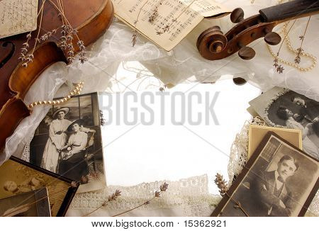 Vintage background with photographs and old broken violin