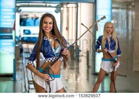 Image of hot brunette posing at vehicle maintenance station