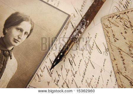 Vintage memories with woman portrait, pen and letters