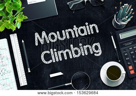 Mountain Climbing Handwritten on Black Chalkboard. 3d Rendering. Toned Image.