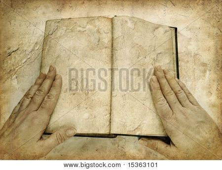 Grunge image of open book with blank pages, with woman hands