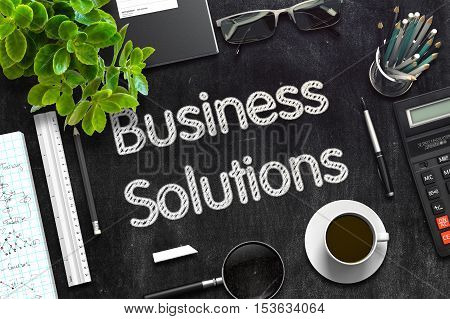 Business Solutions. Business Concept Handwritten on Black Chalkboard. Top View Composition with Chalkboard and Office Supplies. 3d Rendering. Toned Illustration.