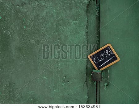 Green painted wall with a door locked and warning message concept of privacy or security
