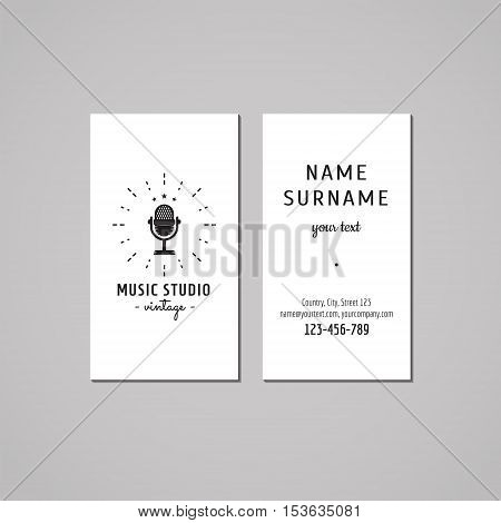Music studio business card design concept. Logo with vintage microphone and rays. Vintage hipster and retro style.