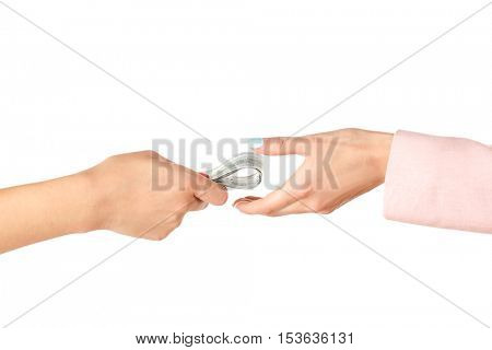 Corruption concept. Female hands with money on white background