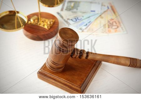 Gavel and scales on white table