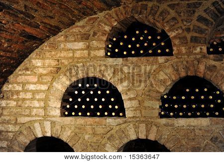 Wine bottles in traditional wine cellar