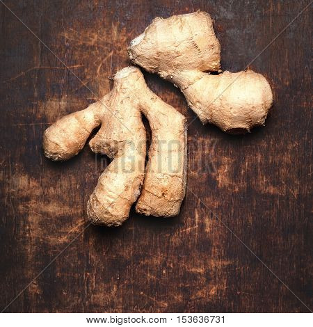 Ginger root on wooden table with copy space in vintage style