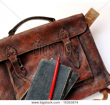 Close up of vintage schoolbag with pen and notes