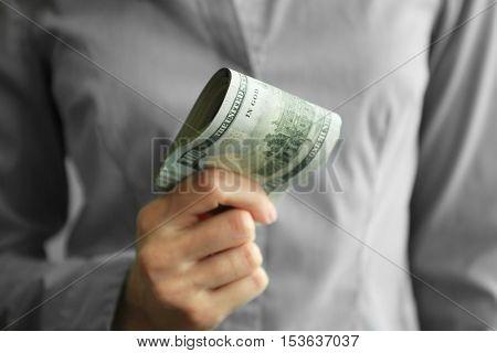 Woman holding money, closeup