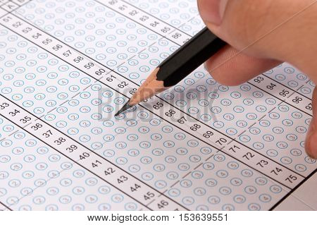 Filling Out In Answer Sheet. Answer Sheet Focus On Pencil. Bubble Answer Sheet With Blank Answer. Mu