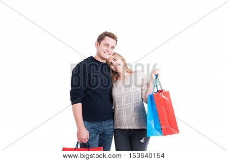 Happy Couple Standing And  Holding Lots Of Shopping Bags