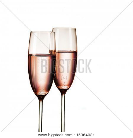 Two glasses of pink champagne, isolated on white background