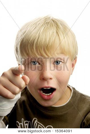 Cute amazed blond boy, pointing with his finger, isolated on white background