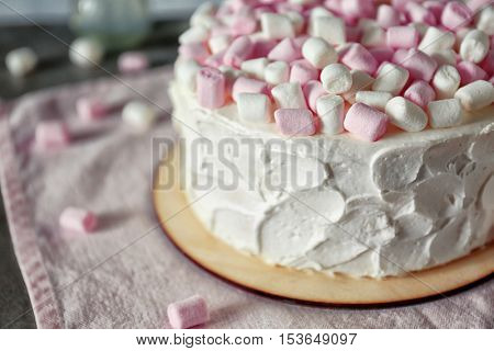 Delicious cake with marshmallows, close up
