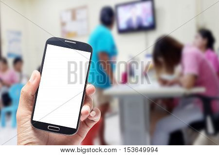 Hand using smartphone holding blank screen mobile phone on blurred background Patient waiting for see doctor abstract background