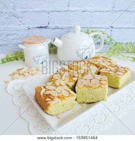 Fresh baked homemade pandan - peanut sponge cakes