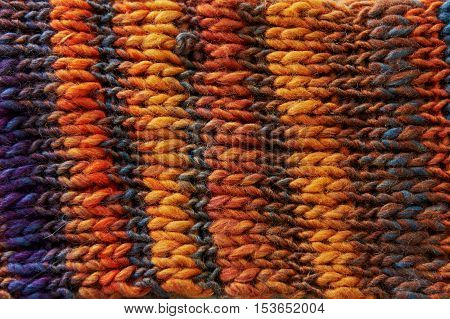 Texture wool knitted orange wool, with color transitions of the gradient. Close