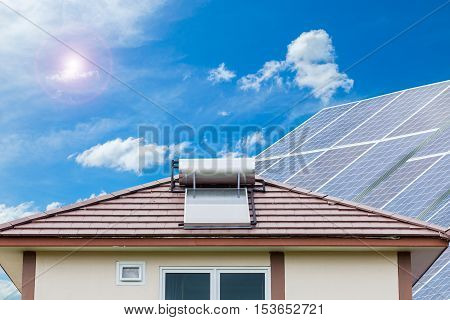 Solar panel for hot water system on roof blue sky background Energy saving and natural energy concept