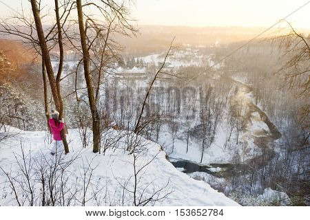Little girl admiring a view of Vilnia river from geological Puckoriai exposure in Vilnius the highest exposure in Lithuania