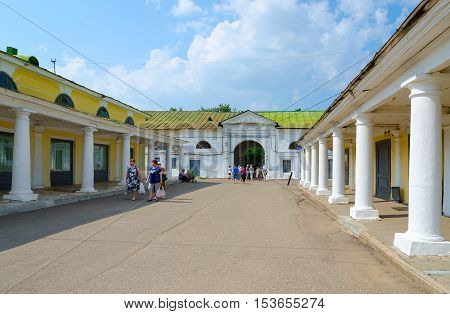 KOSTROMA RUSSIA - JULY 20 2016: Unknown people visit Kostroma trading arcades (commercial and warehouse complex late XVIII-early XIX centuries architectural monument) Golden Ring of Russia