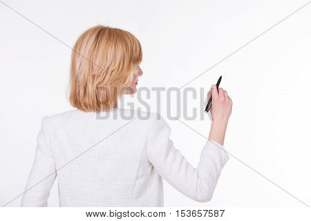 Portrait of young beautiful woman holding a pen on white background. Writing concept