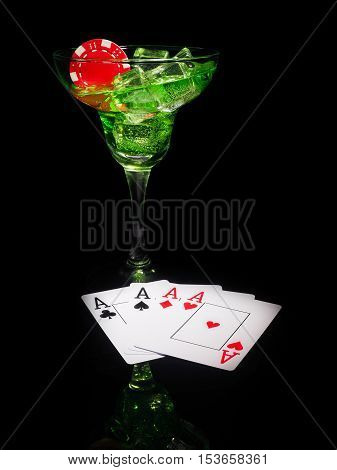 Red dice and a cocktail glass on black background. casino series.