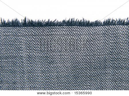 Piece of fabric with fringe on white.