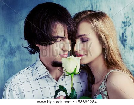 beautiful young couple with a rose