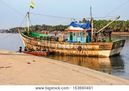 Goa, India - November 15, 2012: Tropical beach with fishing boats Mobor Beach South Goa India