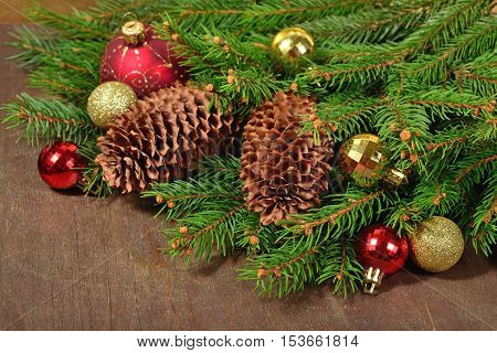 Christmas Decorations And Spruce Branch And Cones